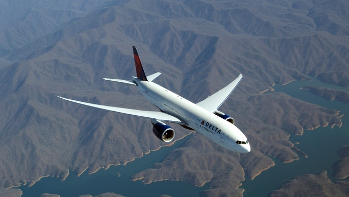 Delta Airlines plane over mountains